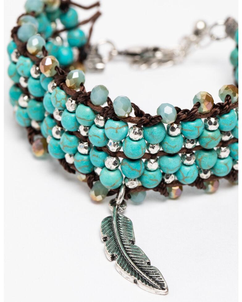Shyanne Women's Blue Falls Interlocked Feather Charm Bracelet, Silver, hi-res